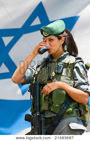 JERUSALEM, ISRAEL - MAY 30: Unidentified Israeli army girl at the Israel Expo, one of the largest celebration of Israeli culture on May 30, 2011 in Jerusalem, Israel.