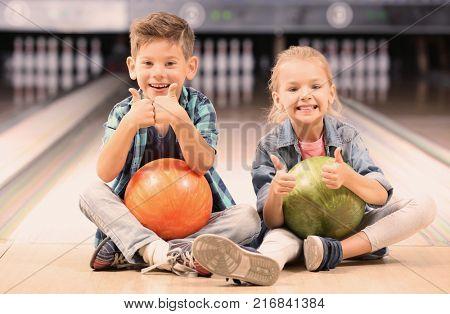 Cute little children at bowling club
