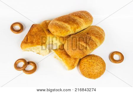 whole wheat two breads, unleavened wheat cake and bun on white background