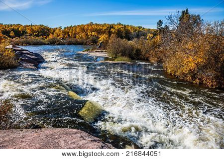Foam water rapids on the smooth stones of the Winnipeg River. Old Pinawa Dam Provincial Heritage Park on the Winnipeg River. The concept of ecological and adventure tourism poster