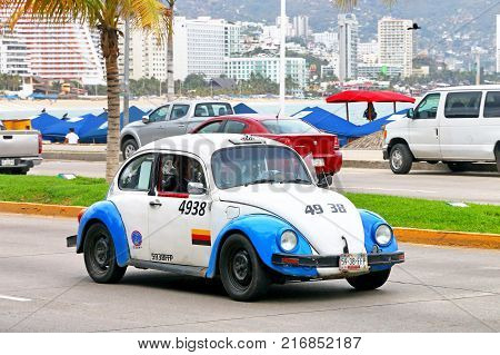 Acapulco Mexico - May 30 2017: Retro cab Volkswagen Beetle in the city street.