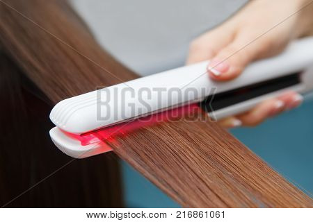 Keratin recovery hair and protein treatment pile with professional ultrasonic iron tool. Concept straighten hair