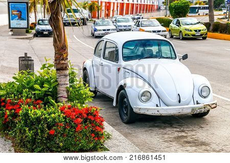 Acapulco Mexico - May 28 2017: White retro car Volkswagen Beetle in the city street.