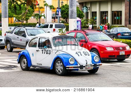 Acapulco Mexico - May 30 2017: Retro taxi car Volkswagen Beetle in the city street.