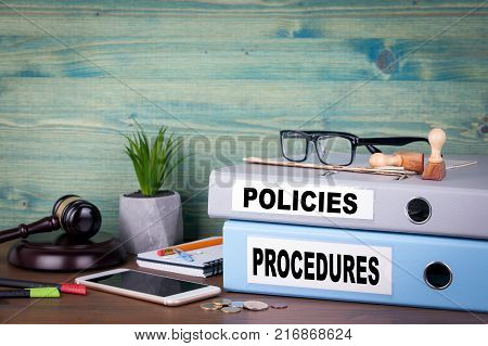 Policies and Procedures. Successful business, law and profit background.