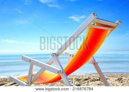 Colorful Beach Chairs And Sun Hat On The Beach