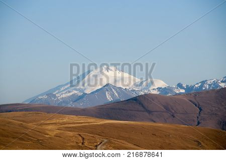 The mountain. snow-capped mountains . Caucasus Mountains . Mountains in the clouds. Beautiful snow-capped mountains