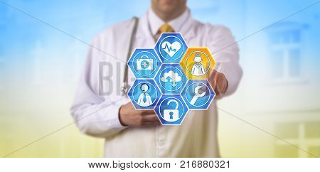 Unrecognizable male doctor activating health services via touch screen. Medical IT concept for managed healthcare virtual care utilization convenient access to remote monitoring and telemedicine.