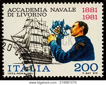 Moscow Russia - December 04 2017: A stamp printed in Italy shows cadet with sextant and sailing ship series