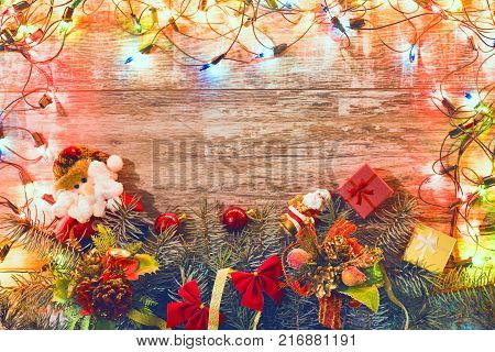 Christmas holiday background. Christmas lights lie on dark, old boards. New Year background. Christmas decorations. Xmax background. Christmas tree.