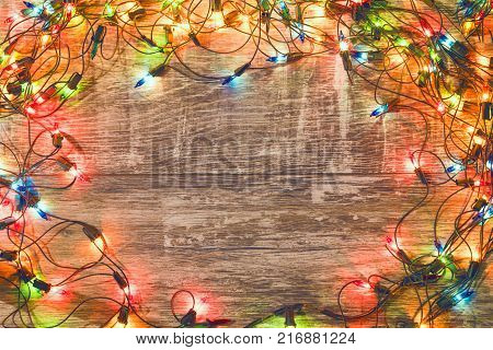 Vintage christmas background. Old Christmas garland on a wooden background. New Year background. Christmas decorations. Xmax background. Toned image.