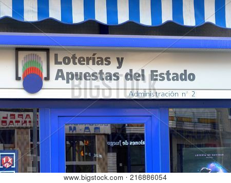 MADRID SPAIN - DECEMBER 5 2017: Lotería nacional. Official logo on the facade of an spanish national lottery outlet. Loterias y apuestas del estado. Spanish national lottery distributes many cash prizes especially at Christmas time. First prize is called