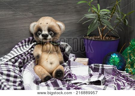 Little felted baby bear on christmas background