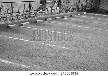 Empty parking lot space black and white tone