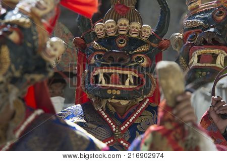 Ancient Tibetan blue ritual sacral Bull Mask with high horns and open mouth with huge fangs and red tongue, Zanskar, Himalayas, Northern India.