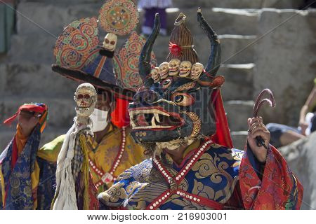 Buddhist lama in the ritual mask performs the sacred Cham Dance in the Tibetan monastery, the Himalayas.