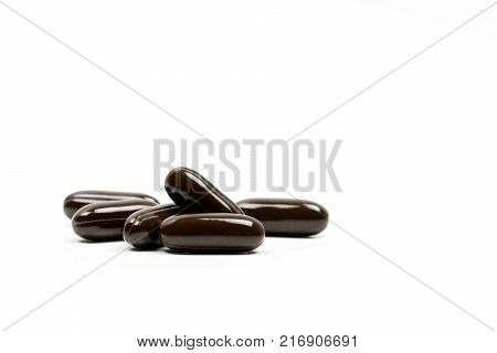 Multivitamins capsule pills for pregnant woman with copy space for text isolated on white background. Vitamins and supplements for hard working guy. Global healthcare concept