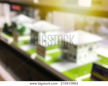 abstract blurred background of house model samples on shelves for real estate and architecture business concept.