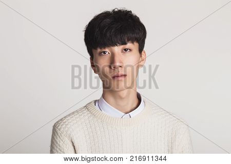 Studio portrait of Asian youth with no motivation