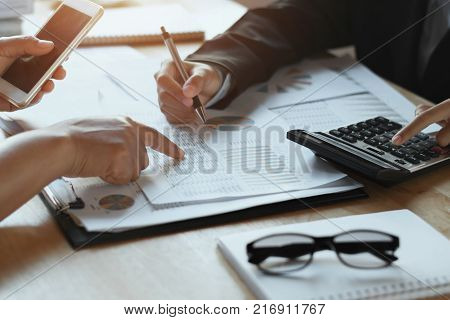 teamwork business woman checking finance report in office. accounting concept