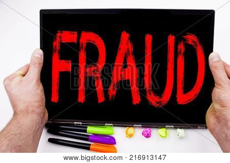 Fraud text written on tablet, computer in the office with marker, pen, stationery. Business concept for Fraud Crime Business Scam white background with space