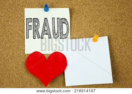 Conceptual hand writing text caption inspiration showing Fraud concept for Fraud Crime Business Scam and Love written on sticky note, cork background with copy space