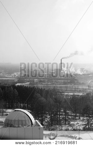 winter cityscape. DomeTrees, wood, track, snow, industrial pipes. Black and white photo