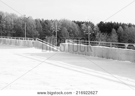 winter landscape. Street, stairs, roll, trees and snow background. Black and white photo