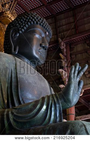 Nara, Japan -  May 29, 2017: The world's largest bronze statue of Buddha in the Great Buddha Hal, Daibutsuden