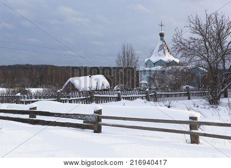 Rustic, winter landscape with a chapel. Chapel of Our Lady of Tikhvin. Village Klopovskaya (Mishin), Velsky District, Arkhangelsk region, Russia