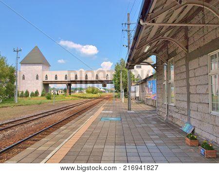 Railroad tracks and platform at Biei station. Biei Station is a railway station on the Furano Line in Biei, Hokkaido, Japan, operated by the Hokkaido Railway Company or JR Hokkaido.