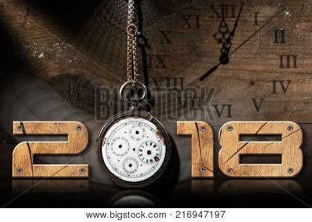 2018 New Year - Wooden numbers with an old and broken pocket watch with chain on a wooden background