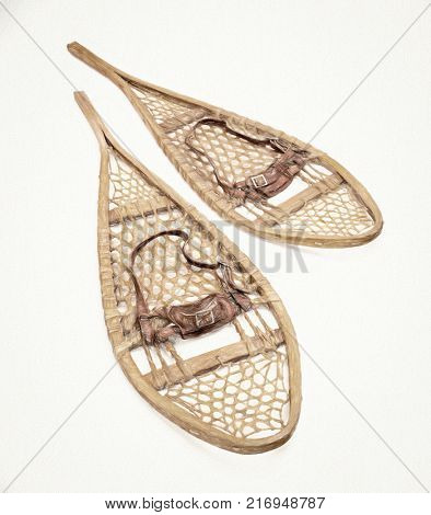 vintage wooden Huron snowshoes with leather binding, a photo with digital painting effect