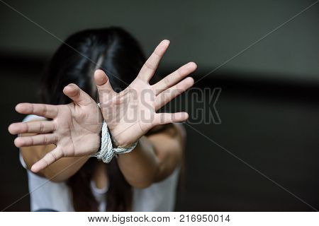 Woman hand were tied with a rope. Stop Violence Terrified Human Rights Day concept.