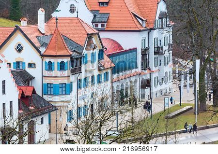 Fussen, Germany - December 27, 2016: Beautiful painted traditional bavarian houses aerial street view near Neuschwanstein and german alps in Bavaria