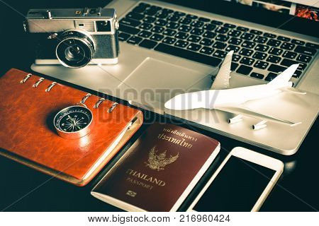 Business travel objects on office desk for Business travel concept