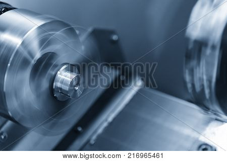 CNC lathe machine (Turning machine) cutting the metal screw thread part .Rotation of aluminium part.