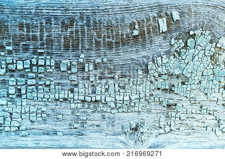 Peeling texture paint on old weathered texture wood - texture background, texture surface of the old wooden planks. Texture of peeling paint, closeup of peeling paint on the wooden background, texture surface. Peeling paint texture background