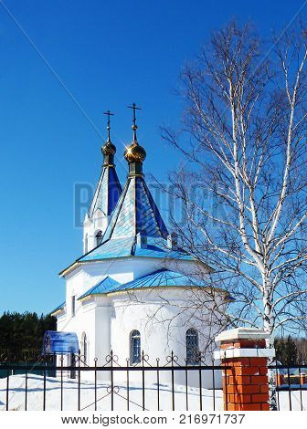 Church Smolenskoy icons Bozhiey Full-grown in village of the stations Mstyora.Winter landscape on background blue sky
