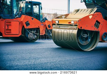Close view on the road roller working on the new road construction site