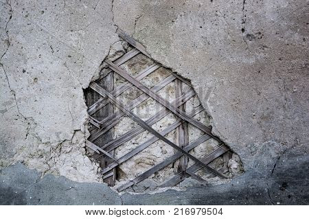 Abstract texture of wall covered with obsolete damaged cement plaster