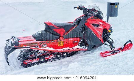 Rovaniemi Finland - March 2 2017: Red snowmobile at frozen lake at winter Rovaniemi Lapland in Finland