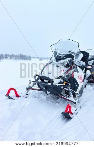 Rovaniemi Finland - March 2 2017: Black snowmobiles on the frozen lake at winter Rovaniemi of Lapland Finland