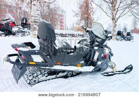 Rovaniemi Finland - March 2 2017: Black snowmobiles in the frozen lake at winter Rovaniemi Lapland of Finland