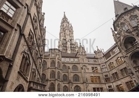 MUNICH, GERMANY - NOVEMBER 17, 2017: Historical towers of New Town Hall -Neues Rathaus- with gothic style walls on November 17, 2017. Munich is the 12th largest city in the European Union