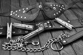 BDSM fetish sex toys bondage composition: leather mask, chain, neck collar, black and white art poster
