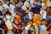 natural background - pile of semi precious jewelery stones closeup. best for craftsmanship, interior design, gift poster