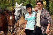 Horseback riders with their horses poster