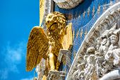 The gilded lion on the top of the Basilica di San Marco facade (Saint Mark`s Basilica) in Venice, Italy. The winged lion is a symbol of Venice. poster