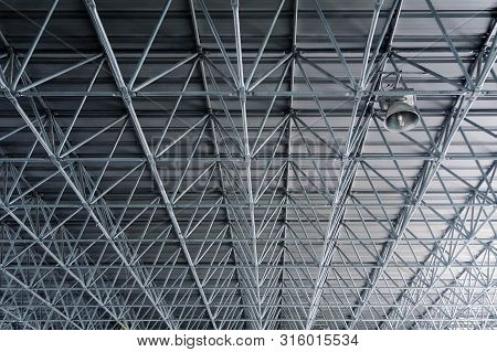Metal Roof Structure Ceiling In Warehouse Architecture Design Concept. Metal Pattern Industry Backgr